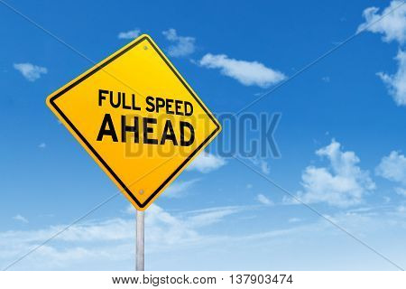 Image of a yellow signboard with text of Full Speed Ahead under clear sky