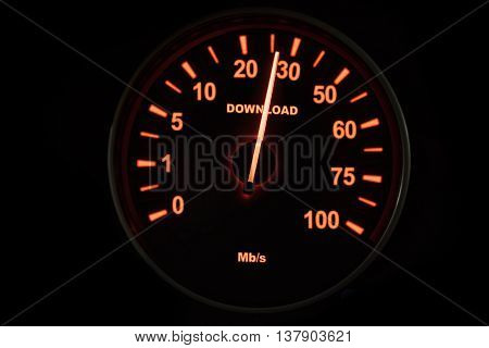 Close up of speedometer testing the download process with speed up to 26 Mbps