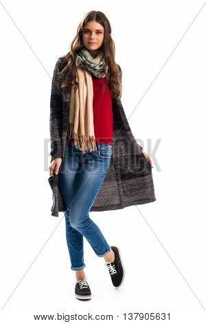 Woman in striped sweater coat. Blue jeans and black shoes. Stylish outerwear for spring. Garment made of wool.
