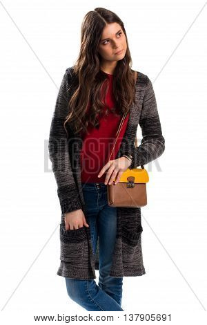 Woman with two tone bag. Sweater coat and denim pants. Warm autumn outfit. Thick fabric of high quality.