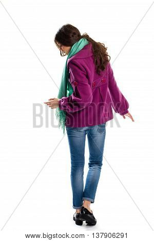 Woman wears purple coat. Back view of short coat. Stylish autumn apparel and footwear. New leather shoes on platform.
