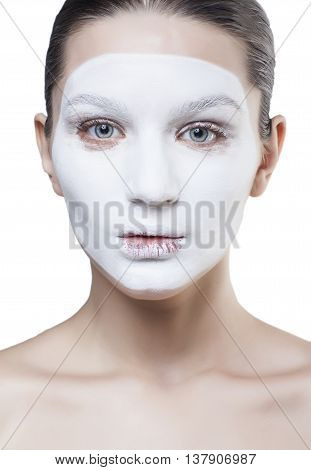 young pretty woman with facial white mask isolated close up spa, wrong panthomimic expression