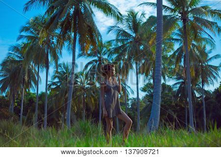 Sensual Boho Woman Posing At Palm Trees Background