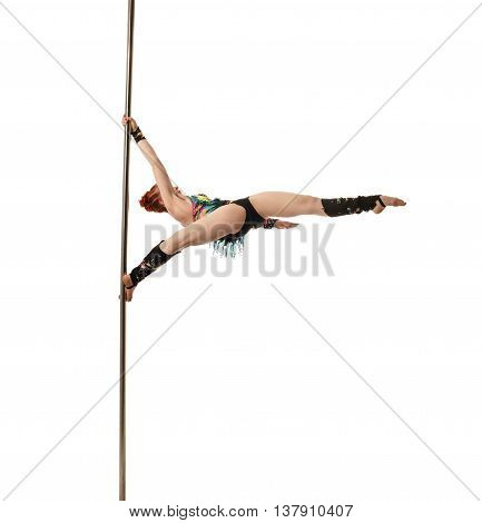 Dance. Pretty female gymnast performs trick on pylon