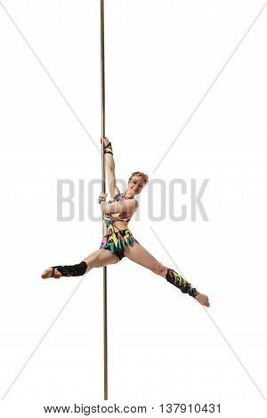 Image of red-haired woman posing while dancing on pylon