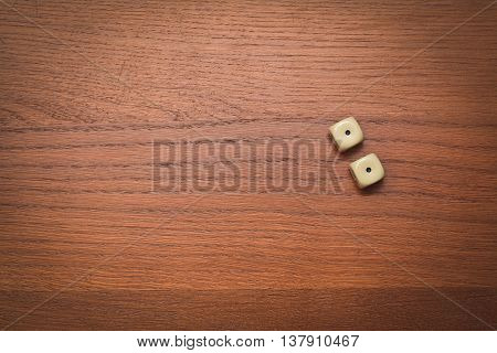two dice number double one on the wooden table
