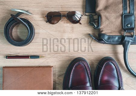 Men clothing and accessories on wooden table with copyspace Vintage tone Top view