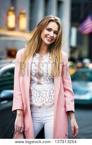 Beautifull happy woman with perfect teeth smile standing in the city street