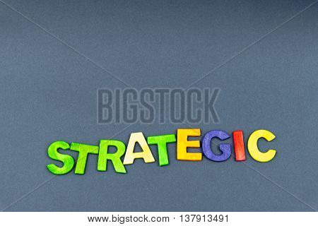 Word Strategic Created Of Wood Letters On Dark Background
