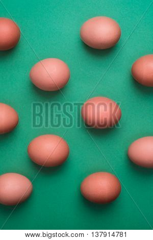 Eggs Viewed From Above On Green Background