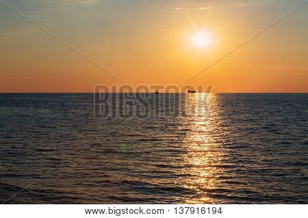 Beautiful reflection of rays setting sun in the Black Sea. Sevastopol, Crimea. Russia