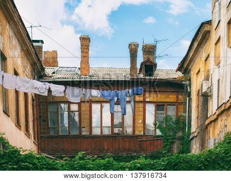 Old courtyard with hanging laundry. Picturesque courtyard