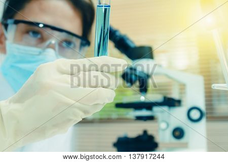 Young scientist works in modern biological lab