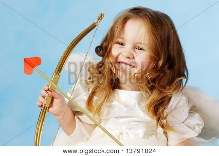 Cute female cupid holding bow