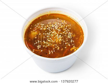 Asian japanese cuisine - red fish soup with sesame isolated at white background, diet and vegetarian food
