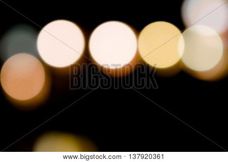 Out-of-focus city lights at night with copy space