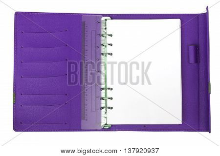 A violet notebook with white blank page