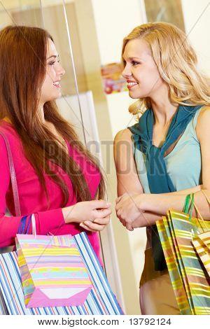 Image of two women talking in shop