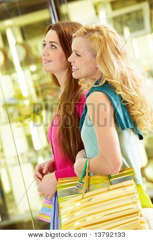 Two young beautiful women shopping together
