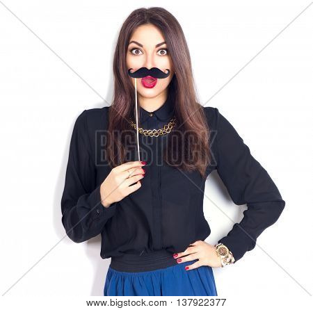 Surprised young Woman holding funny mustache on stick. Joyful model Girl ready for party, isolated on white background