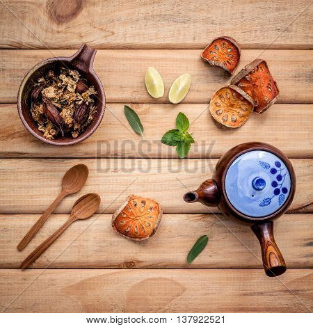Herbal Tea Pot With Fresh Herbs Sage ,peppermint ,dried Indian Bael, Honey, Lime And Lemon On Rustic
