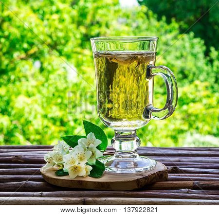 jasmine tea and jasmine flowers on vintage wooden table