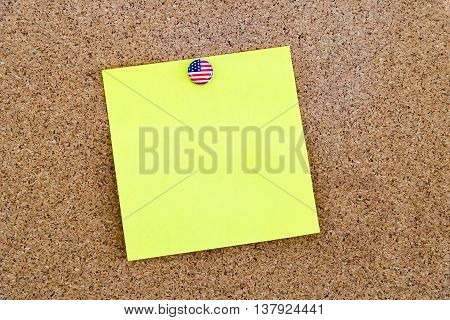 Blank Yellow Paper Note Pinned With United States Flag Thumbtack