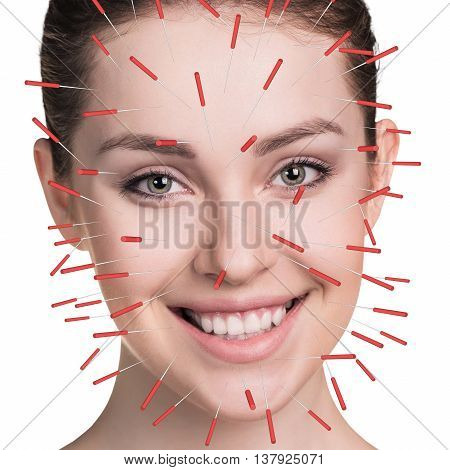 Closeup of performing acupuncture therapy on face isolated on white