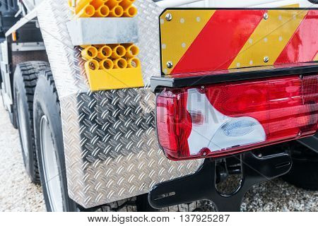 yellow locking block and tail lights of the truck. Focus on tail lights of the truck