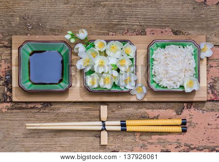 healthy power concept Eco a dish with jasmine rice and jasmine flowers on a wooden background retro style