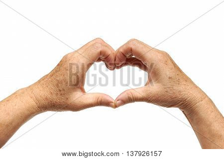old female hands with freckles forming a heart shape