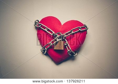 A heart tied with chains and locks