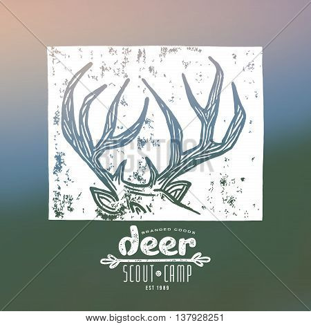 Stock vector linocut with a image of deer horns. Graphic design for t-shirt. White print on blurred background