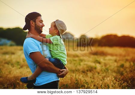 Happy family. Father and son playing and embracing the outdoors. Father's day