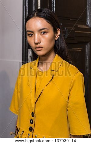 MILAN ITALY - JUNE 19: Beautiful model poses in the backstage just before Damir Doma SS 17 show during Milan Men's Fashion Week on JUNE 19 2016 in Milan.