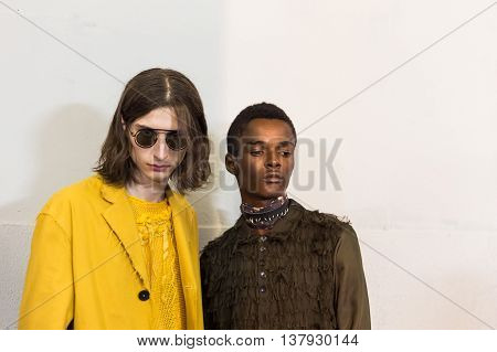 MILAN ITALY - JUNE 19: Beautiful models pose in the backstage just before Damir Doma SS 17 show during Milan Men's Fashion Week on JUNE 19 2016 in Milan.