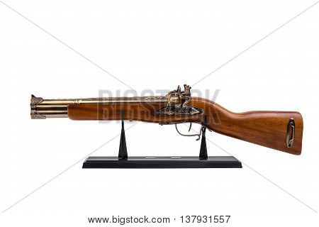 Vintage Wooden Rifle On A Black Stand,isolated On White Background