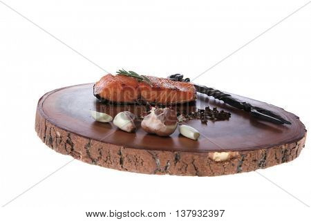 breakfast delicious portion fresh roast salmon fillet dry spices garlic and rosemary wooden plate black forged handmade fork healthy food diet cooking concept isolated on white background empty space