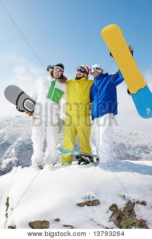 Portrait of three sportsmen standing on the mountain