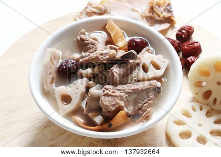 Chinese traditional Pork rib soup with lotus root, dried squid, peanut and red dates