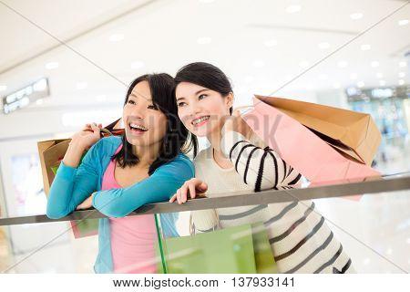 Two women shopping inside department store
