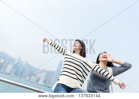 Thrilled woman enjoy travel in Hong Kong
