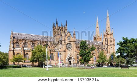 Sydney - February 25 2016: Beautiful gothic Catholic Cathedral St. Mary's and Hyde Park in a good clear day February 25 2016 Sydney Australia