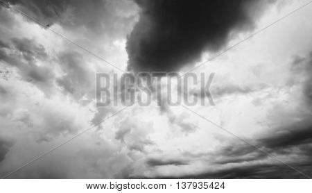 Grey sky with white and black clouds