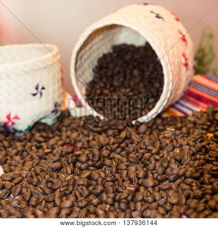 Close Up Of Brown Coffee Beans And White Wicker Bowl