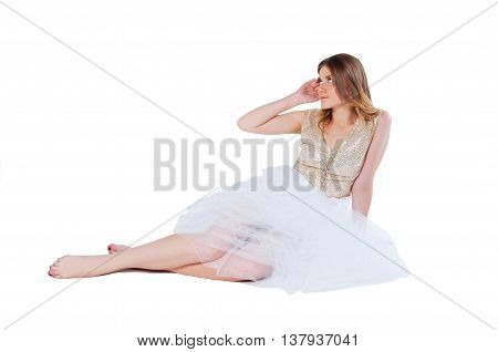 Glamorous beautiful blonde woman in golden sequin outfit and tulle white skirt with glitter makeup isolated on white