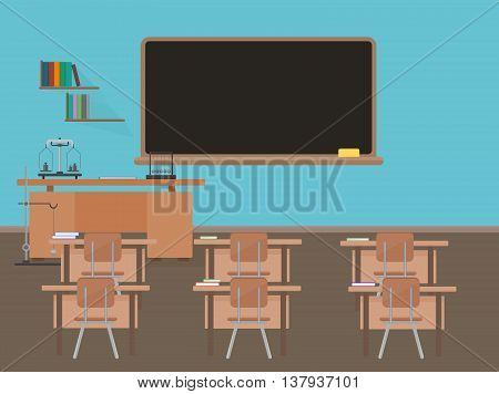 Empty school classroom with blackdesk, pupils tables and chairs