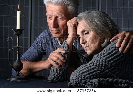 Portrait of a sad senior couple close up