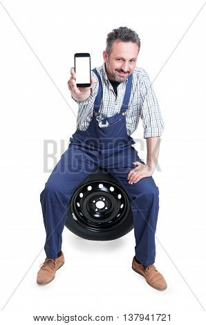 Handsome Confident Mechanic Showing Cellphone With Blank Screen