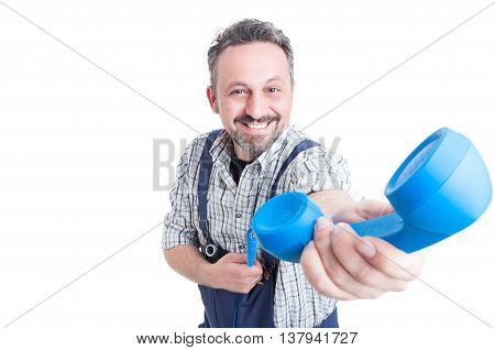 Smiling Mechanic Giving A Blue Telephone Receiver